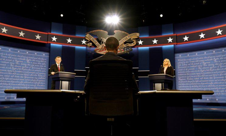 Hostra University students playing the roles of the candidates and moderator go through a rehearsal for the first presidential debate in Hempstead, N.Y., on Sunday. (Rick Wilking/Reuters)