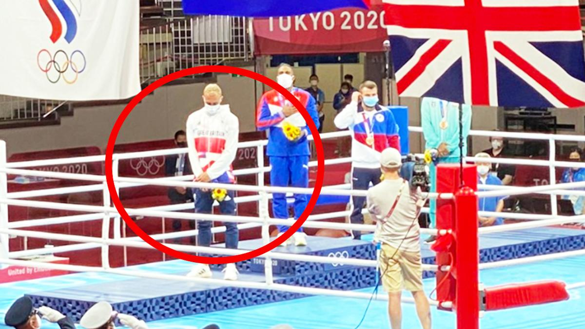 'This is shameful': Olympic boxer divides over 'foolish' podium act