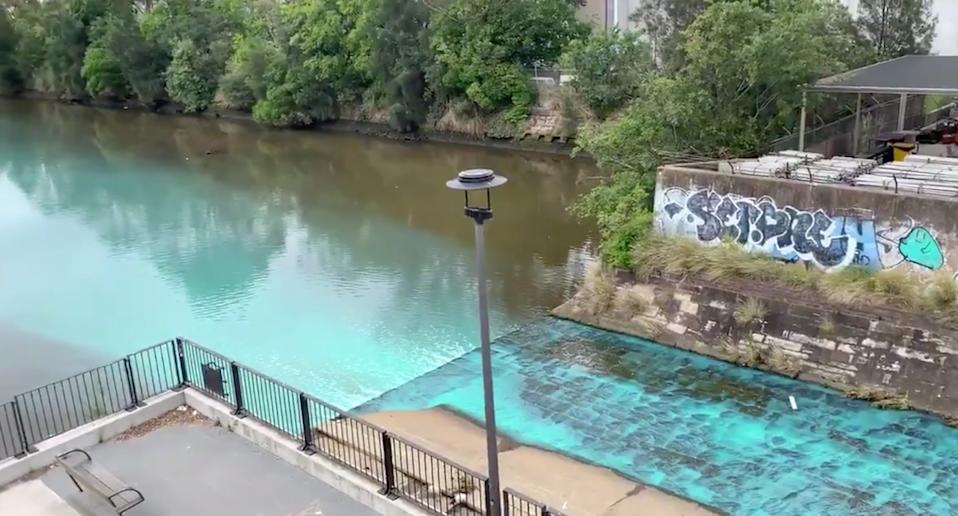 The  Alexandra Canal with bright blue water running through it.