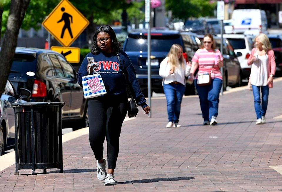 Shoppers on the Country Club Plaza could shed their masks and enjoy the spring weather as Mayor Quinton Lucas announced Friday the city is fully lifting its emergency order.