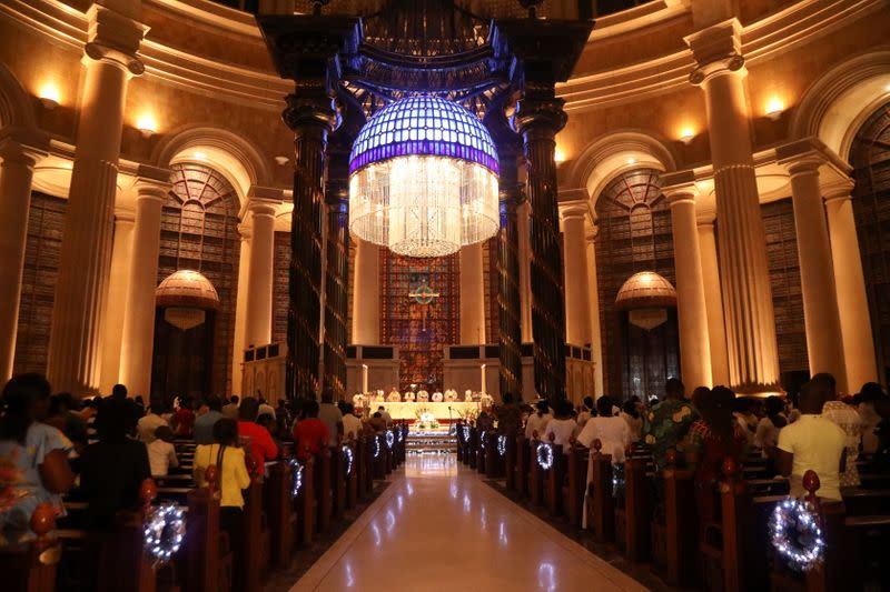 Worshippers attend the celebration of Christmas at the Basilica Notre Dame in Yamoussoukro