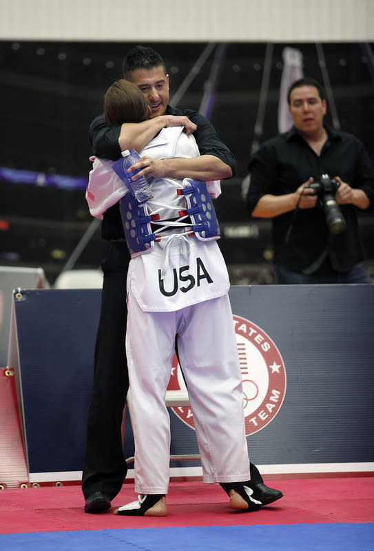 COLORADO SPRINGS, CO - MARCH 10: Diana Lopez gets a hug from her coach and older brother Jean Lopez after defeating Danielle Holmquist in the 2012 Taekwondo Olympic Trials at the U.S. Olympic Training Center on March 10, 2012 in Colorado Springs, Colorado. Lopez won the match 3-1. (Photo by Marc Piscotty/Getty Images)
