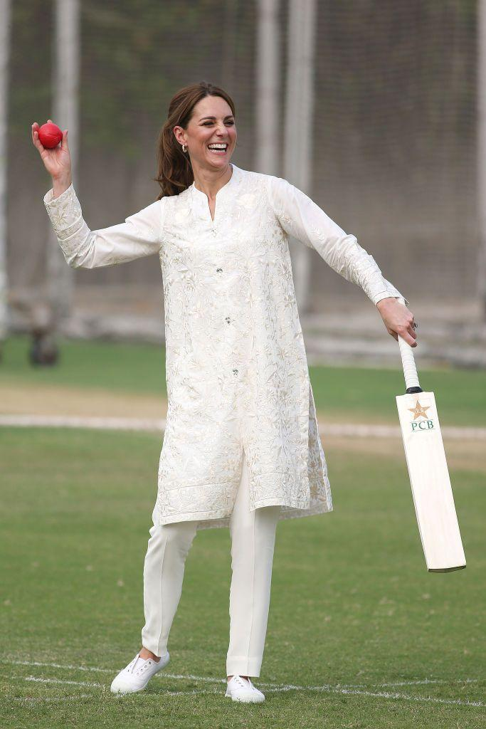 <p>On the fourth day of Kate and Prince William's royal tour of Pakistan, the royal couple visited the National Cricket Academy, and even tried to play the sport. For the casual event, the Duchess paired sneakers with a shalwar kameez by Gul Ahmed.</p>