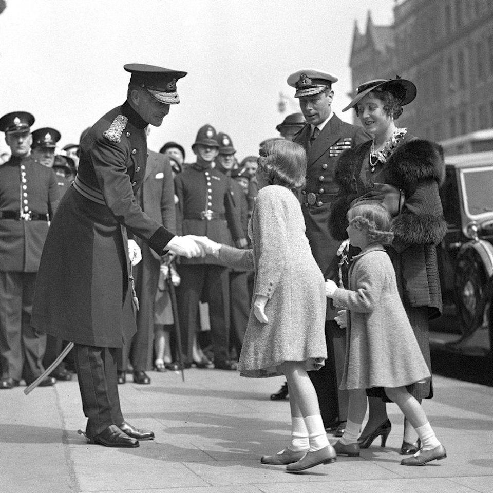 <p>Elizabeth sakes hands as she arrives at the Royal Tournament (PA Archive) </p>
