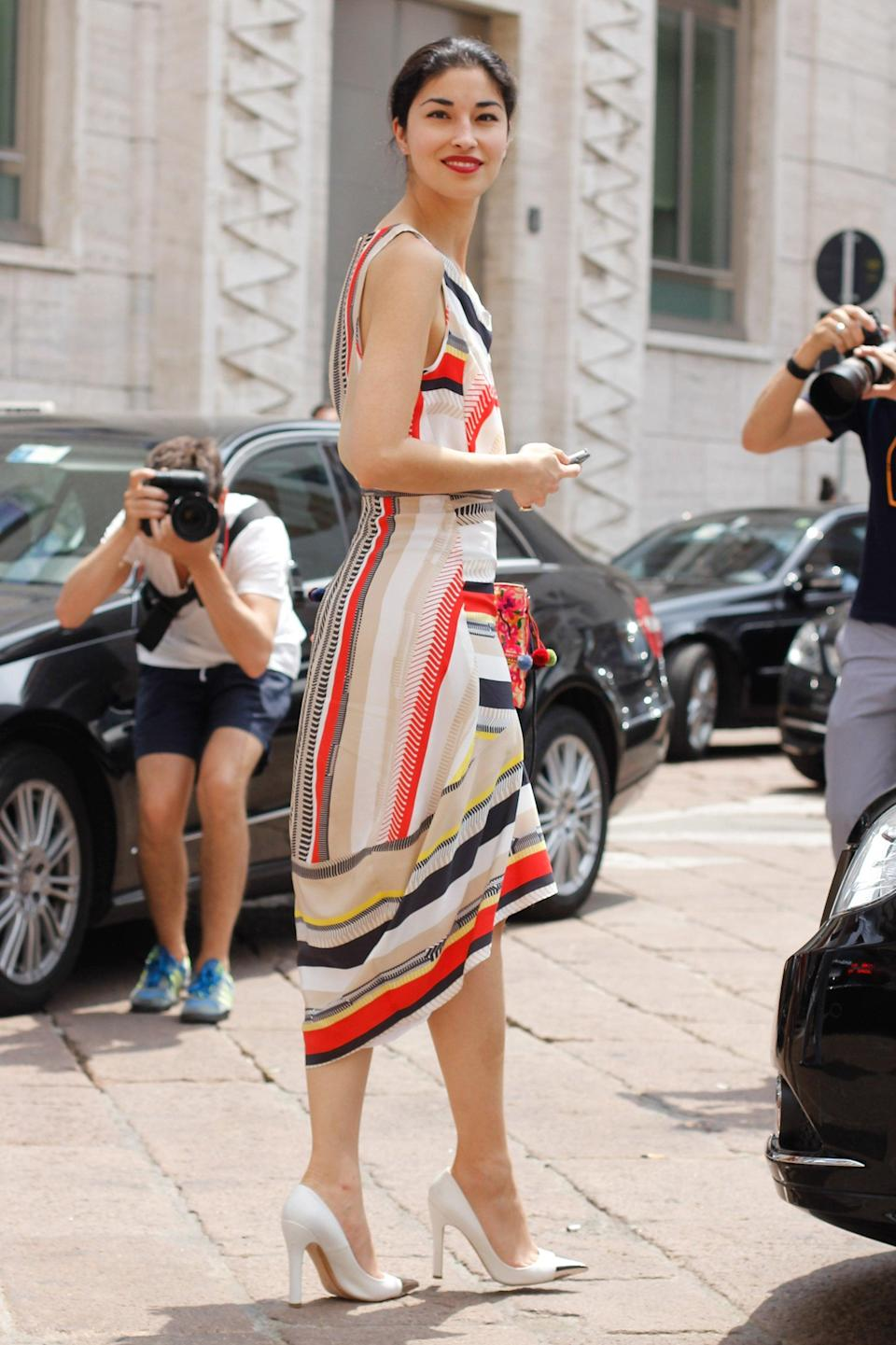 <p>Caroline Issa is at it again in the coolest kind of striped dress and metallic toe-cap heels.</p>