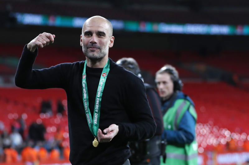 Manchester City's head coach Pep Guardiola celebrates after winning the English League Cup Final soccer match between Aston Villa and Manchester City, at Wembley stadium, in London, England, Sunday, March 1, 2020. (AP Photo/Alastair Grant)