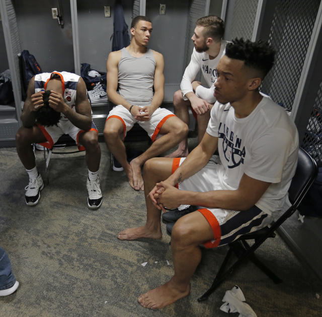 Virginia players sit in the locker room after their 74-54 loss to UMBC in a first-round game in the NCAA men's college basketball tournament in Charlotte, N.C., Friday, March 16, 2018. (AP Photo/Bob Leverone)