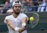 Russia's Karen Khachanov plays a return to Canada's Denis Shapovalov during the men's singles quarterfinals match on day nine of the Wimbledon Tennis Championships in London, Wednesday, July 7, 2021. (AP Photo/Alastair Grant)