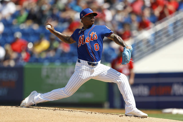 New York Mets pitcher Marcus Stroman throws a pitch to the St. Louis Cardinals during the first inning of a spring training baseball game, Wednesday, March 4, 2020, in Port St. Lucie, Fla. (AP Photo/Julio Cortez)
