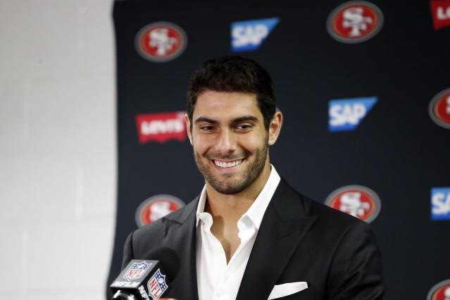 San Francisco quarterback Jimmy Garoppolo was all smiles after winning his first start with the 49ers. (AP)
