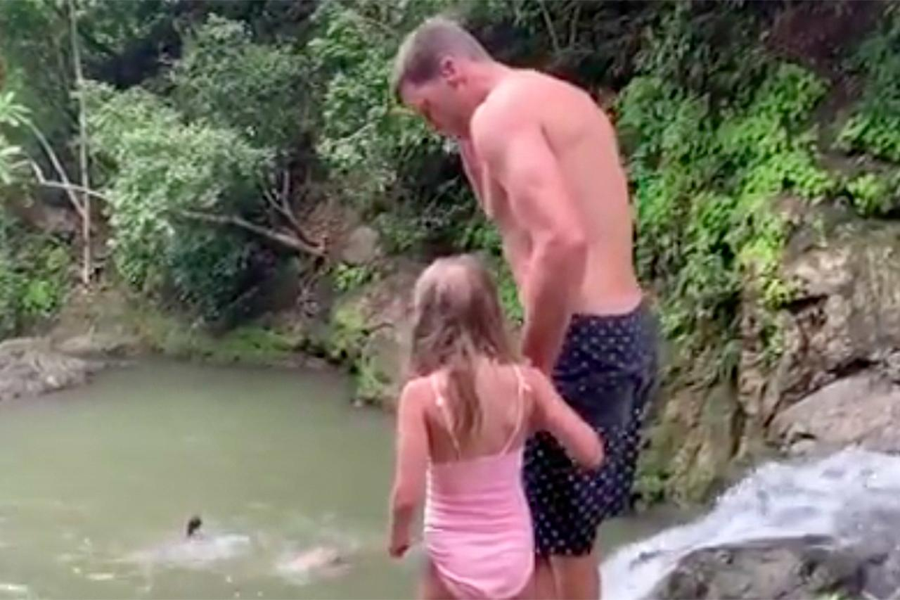"""During their family vacation in Costa Rica in July, Brady and daughter Vivian got a little adventurous and jumped over a small waterfall into a natural pool. In the video posted to his Instagram, Brady holds her hand and instructs her to """"jump all the way out"""" before counting down and diving in — while Vivian visibly hesitates before being following suit. """"You almost didn't jump!"""" he jokes once she's beside him in the water.  """"If Vivi is going to be an Olympic champion one day, it probably won't be in synchronized diving. Daddy always gives her a 10 though!"""" he added <a href=""""https://www.instagram.com/p/B0HJKGQh5Wp/"""">on Instagram</a>."""