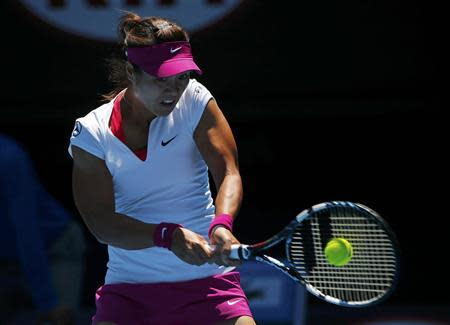 Li Na of China hits a return to Eugenie Bouchard of Canada during their women's singles semi-final match at the Australian Open 2014 tennis tournament in Melbourne January 23, 2014. REUTERS/Petar Kujundzic