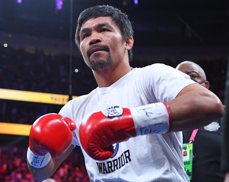 Aug 21, 2021; Las Vegas, Nevada; Manny Pacquiao is pictured before the start of a world welterweight championship bout against Yordenis Ugas at T-Mobile Arena. Mandatory Credit: Stephen R. Sylvanie-USA TODAY Sports