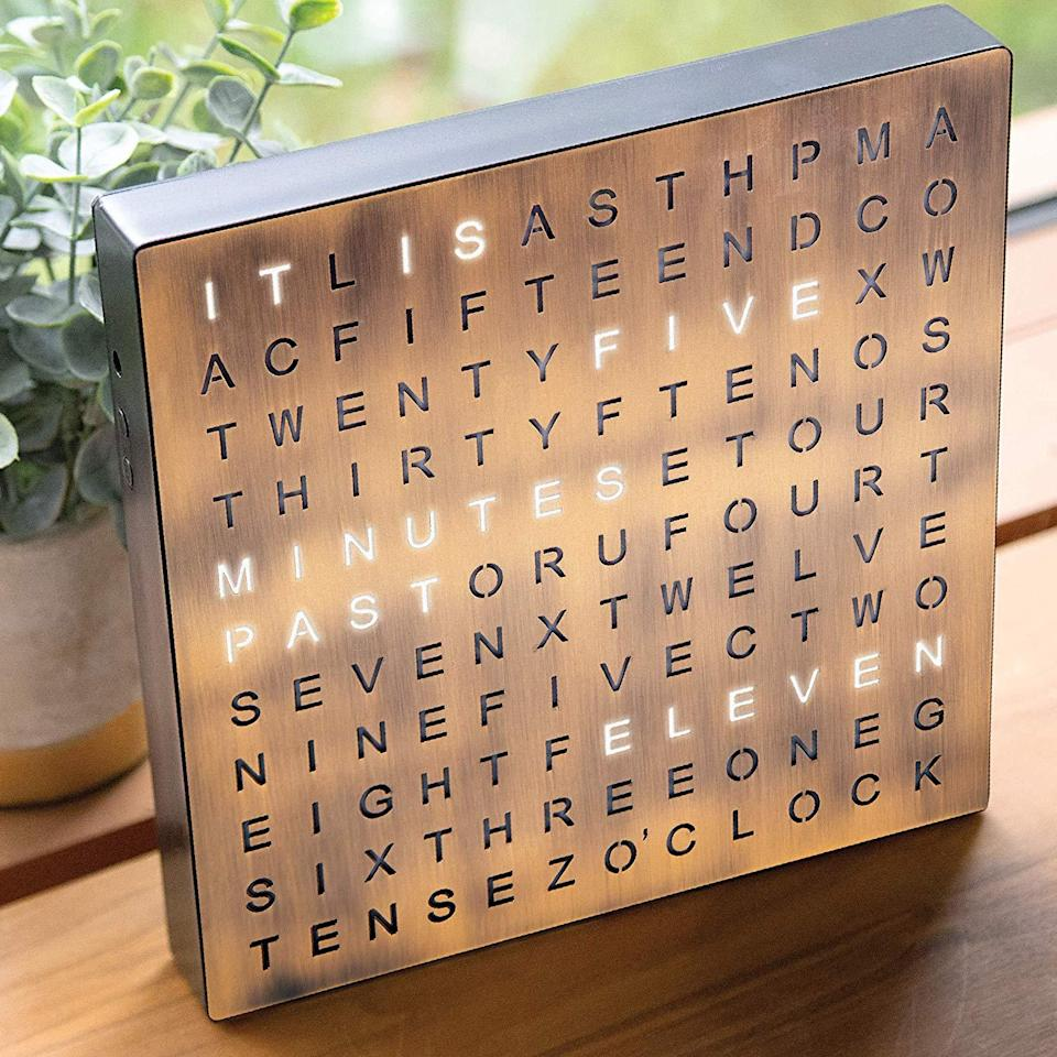 "<h3><a href=""https://amzn.to/2YpLPZ6"" rel=""nofollow noopener"" target=""_blank"" data-ylk=""slk:Light-Up Word Clock"" class=""link rapid-noclick-resp"">Light-Up Word Clock</a> </h3><br>This unique, copper-finished clock tells the time in words instead of numbers — and also serves as an industrial-chic decor piece. <br><br><strong>Sharper Image</strong> Light-Up Word Clock, $, available at <a href=""https://amzn.to/34rDYxl"" rel=""nofollow noopener"" target=""_blank"" data-ylk=""slk:Amazon"" class=""link rapid-noclick-resp"">Amazon</a>"