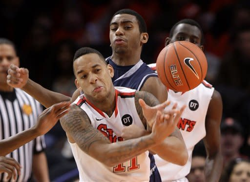 St. John's D'Angelo Harrison, left, and Georgetown's Hollis Thompson vie for the ball during the second half of an NCAA college basketball game in New York, Sunday, Jan. 15, 2012. Georgetown beat St. John's 69-49. (AP Photo/Seth Wenig)