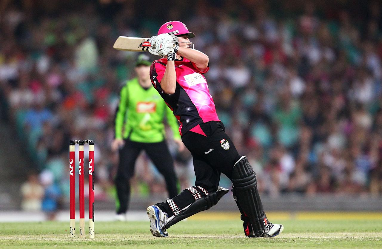 SYDNEY, AUSTRALIA - DECEMBER 08: Nic Maddinson of the Sixers bats during the Big Bash League match between the Sydney Sixers and the Sydney Thunder at Sydney Cricket Ground on December 8, 2012 in Sydney, Australia.  (Photo by Mark Nolan/Getty Images)