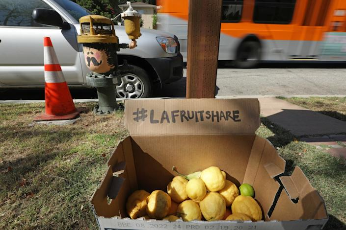 """A box of citrus is offered for sharing in front of a home in Silver Lake. <span class=""""copyright"""">(Myung J. Chun / Los Angeles Times)</span>"""