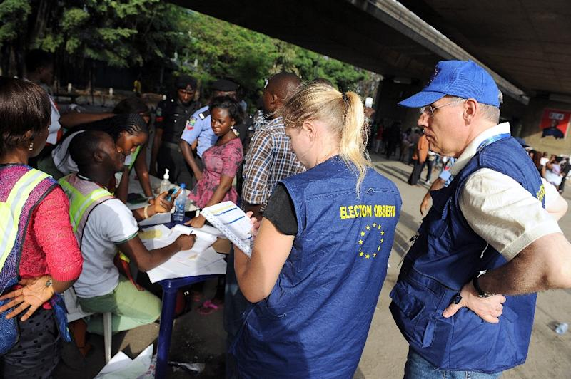 European Union observers take notes as officials of Independent National Electoral Commission count ballots during gubernatorial and local assembly elections in Lagos, Nigeria, on April 11, 2015 (AFP Photo/Pius Utomi Ekpei)