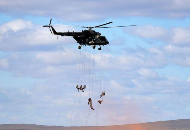 PHOTO: Soldiers rappel from a military helicopter over the training ground 'Tsugol', north of the city of Chita during the military exercises Vostok 2018 in Eastern Siberia, Russia, Sept. 13, 2018. (Sergei Grits/AP)