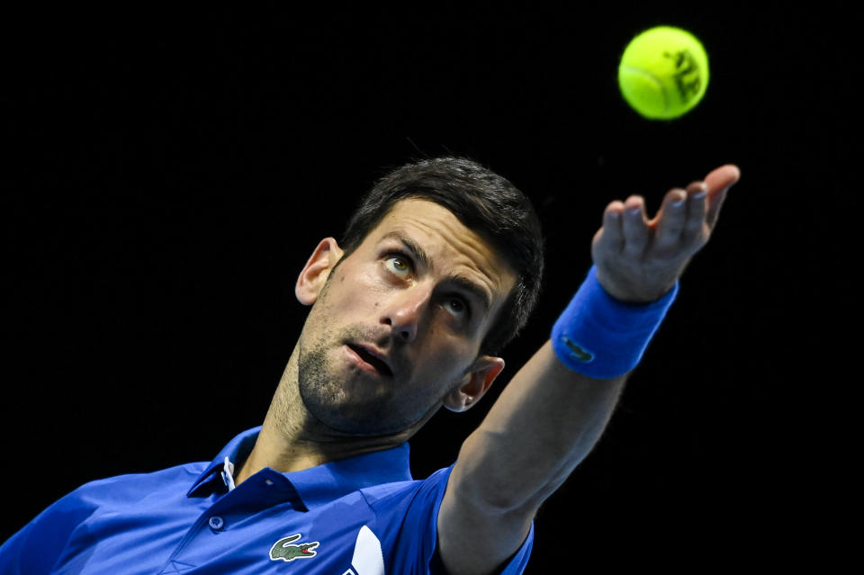 LONDON, ENGLAND - NOVEMBER 21: Novak Djokovic of Serbia serves against Dominic Thiem of Austria during Day 7 of the Nitto ATP World Tour Finals at The O2 Arena on November 21, 2020 in London, England. (Photo by TPN/Getty Images)