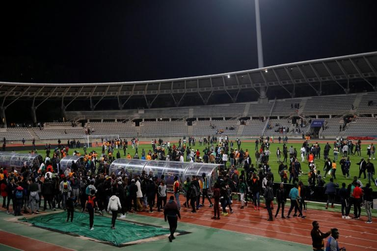 Supporters walk on the pitch after inviding it leading the referee to bring the friendly football match Ivory Coast vs Senegal to a premature end, on March 27, 2017, at the Charlety Stadium in Paris