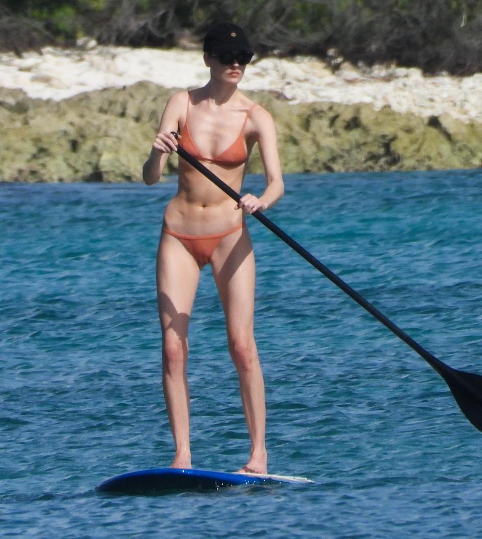 <p>Martha Hunt goes paddle boarding while in Mexico on Thursday with fiancé Jason McDonald.</p>