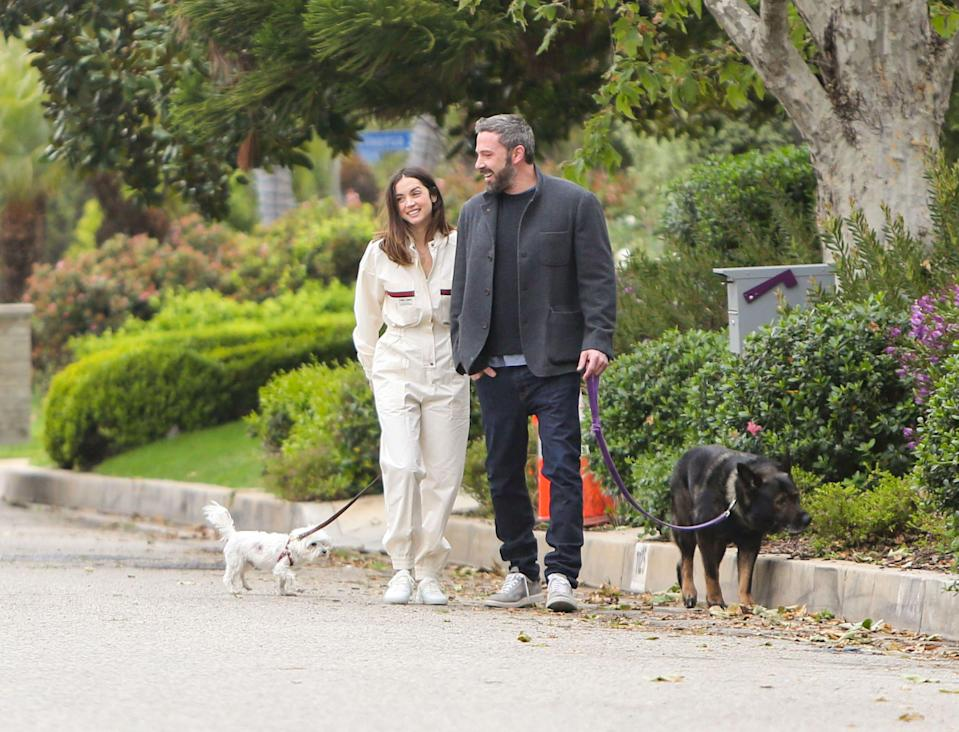 """<p>While most celebs hunkered down in their homes during the COVID-19 pandemic, Ben Affleck and Ana de Armas were some of the few A-list celebs paparazzi could regularly count on being out and about no matter what.<br></p><p>Since making things official right around the time the world went into shutdown mode, Ben and Ana have regularly been captured by paps walking their dogs, house hunting, getting locked out, nuzzling in their masks (other times without), laughing—<a href=""""https://twitter.com/imteddybless/status/1279104141768503300"""" rel=""""nofollow noopener"""" target=""""_blank"""" data-ylk=""""slk:always laughing"""" class=""""link rapid-noclick-resp"""">always laughing</a>, and <a href=""""https://twitter.com/ezwrites/status/1251232043855425537/photo/1"""" rel=""""nofollow noopener"""" target=""""_blank"""" data-ylk=""""slk:toting Dunkin' Donuts iced coffee"""" class=""""link rapid-noclick-resp"""">toting Dunkin' Donuts iced coffee</a> on the daily. The mundanity of it all has seemingly become a kind of comfort reminiscent of times pre-Covid.</p><p>What it's also done is give onlookers another glimpse at Ben and Ana's somewhat mysterious relationship. For a while, all fans knew was that the couple got to know each other on the set of their film <em>Deep Water </em>back in 2019. Then, they were photographed in Cuba together a few months later. Since then, the bulk of public knowledge about this couple has been pieced together from the paparazzi content that's flooded the internet without context or explanation over these last few months. </p><p>So it's understandable if you're after some concrete answers.</p><p>While you <em>could</em> assume isolating together has been working out for them, you can never really know with these things. That's where a body language analyst like <a href=""""https://karendonaldsoninc.com/"""" rel=""""nofollow noopener"""" target=""""_blank"""" data-ylk=""""slk:Karen Donaldson"""" class=""""link rapid-noclick-resp"""">Karen Donaldson</a> comes in clutch. The expert took a look the couple's moves and explained what"""