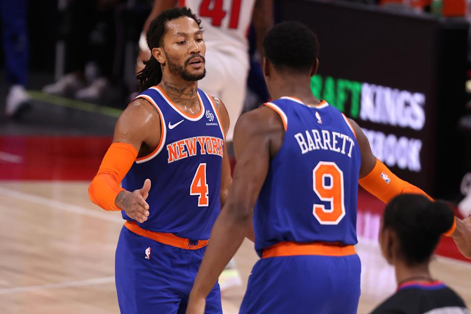 Derrick Rose #4 of the New York Knicks celebrates with RJ Barrett #9 during the second half while playing the Detroit Pistons at Little Caesars Arena on February 28, 2021 in Detroit, Michigan. NOTE TO USER: User expressly acknowledges and agrees that, by downloading and or using this photograph, User is consenting to the terms and conditions of the Getty Images License Agreement. (Photo by Gregory Shamus/Getty Images)