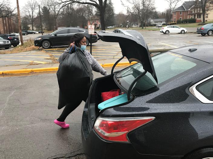 Jada Stewart, a junior at Albion College, loads her belongings into her mother's car on Nov. 15 as she moves back to her home in Chicago.