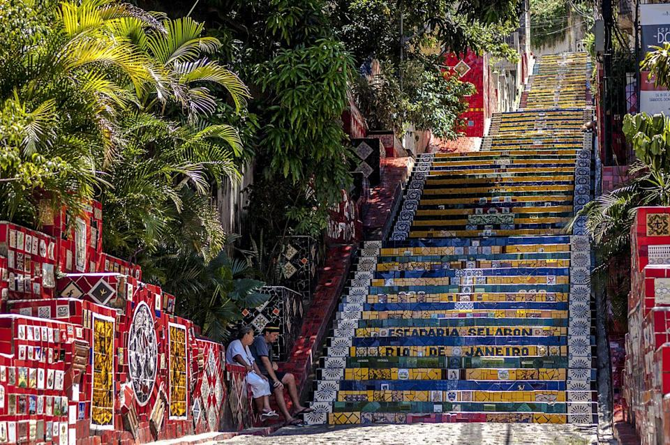 """<p>You can 'explore' the colorful Escadaria Selarón (Selarón Staircase) of Rio de Janeiro or the respected Teotihuacan Pyramid (Pyramids of the Sun) of Mexico right from your computer desk at home. Sites like <a href=""""https://go.redirectingat.com?id=74968X1596630&url=https%3A%2F%2Fwww.kayak.com%2Fc%2Fescape%2Fvirtual-guides%2Frio-de-janeiro%2F&sref=https%3A%2F%2Fwww.redbookmag.com%2Flife%2Fg37623302%2Fhispanic-heritage-month-activities%2F"""" rel=""""nofollow noopener"""" target=""""_blank"""" data-ylk=""""slk:Kayak"""" class=""""link rapid-noclick-resp"""">Kayak</a> and <a href=""""https://www.youvisit.com/tour/panoramas/teotihuacan/85155?id=36553"""" rel=""""nofollow noopener"""" target=""""_blank"""" data-ylk=""""slk:YouVisit"""" class=""""link rapid-noclick-resp"""">YouVisit</a> offer virtual tours for free.</p>"""