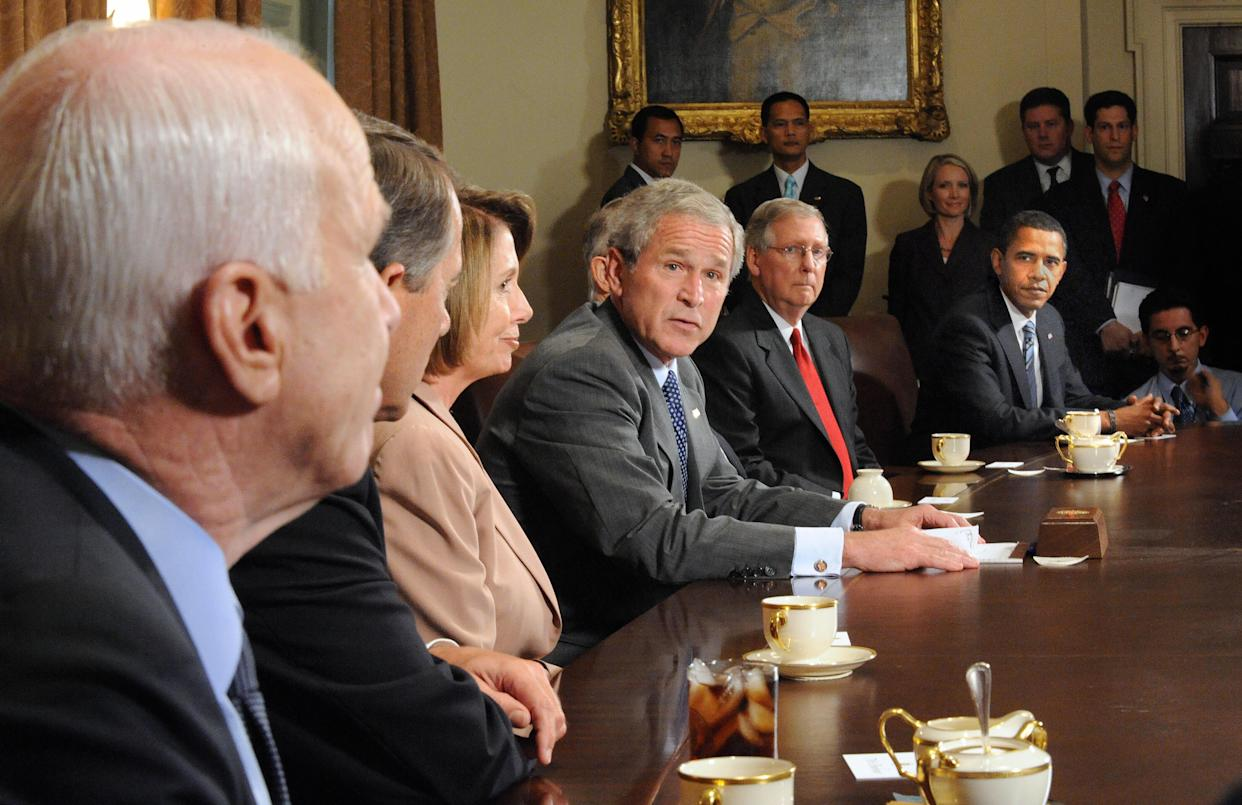 President George W. Bush makes remarks about the economic crisis during a meeting at the White House with members of Congress, including presidential candidates Sen. John McCain and Sen. Barack Obama, on Sept. 25, 2008. (Photo: Tim Sloan/AFP/Getty Images)