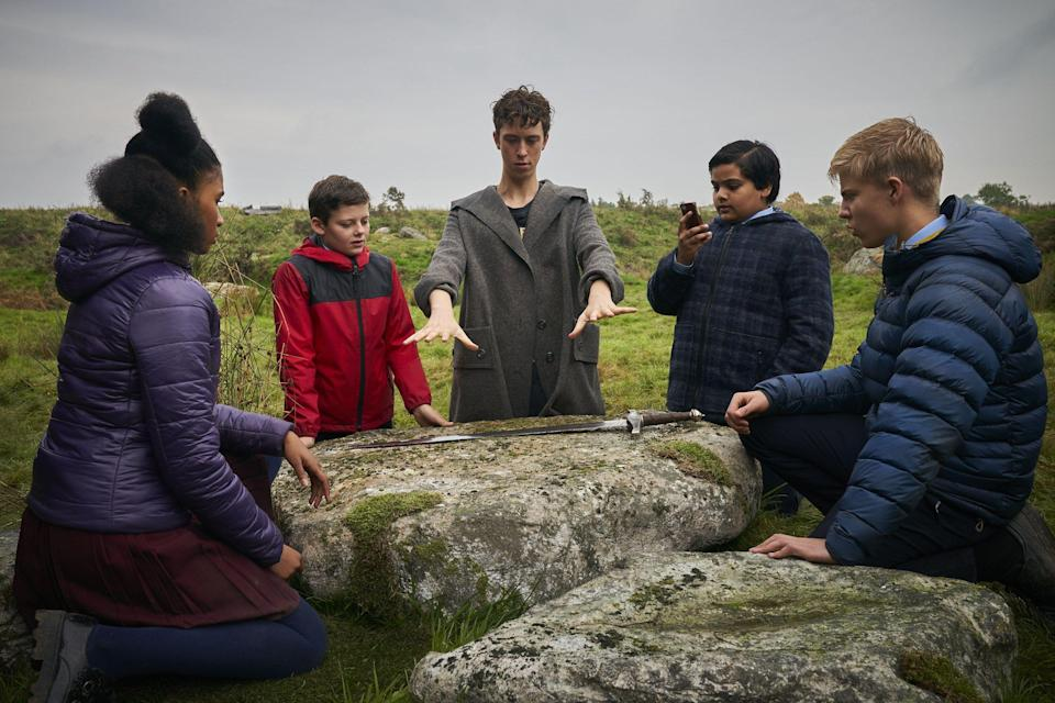 Angus Imrie (centre) plays young Merlin in The Kid Who Would Be King (Credit: Fox)