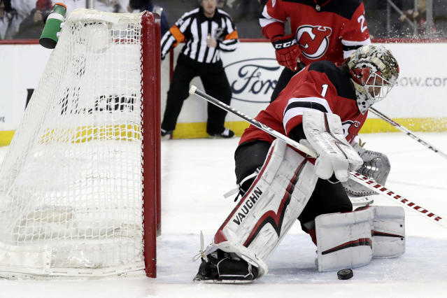 New Jersey Devils goaltender Keith Kinkaid (1) blocks a shot from the Carolina Hurricanes during the first period of an NHL hockey game, Sunday, Feb. 10, 2019, in Newark, N.J. (AP Photo/Julio Cortez)