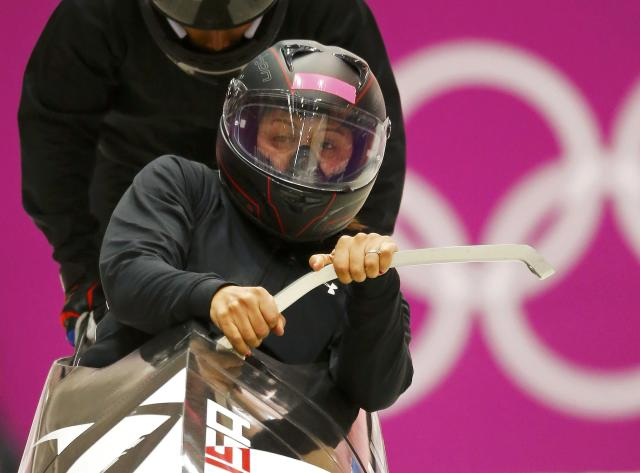Pilot Elana Meyers of the U.S. starts a two-women bobsleigh training at the Sanki Sliding Center in Rosa Khutor, a venue for the 2014 Sochi Winter Olympics near Sochi, February 16, 2014. REUTERS/Arnd Wiegmann (RUSSIA - Tags: SPORT BOBSLEIGH OLYMPICS)
