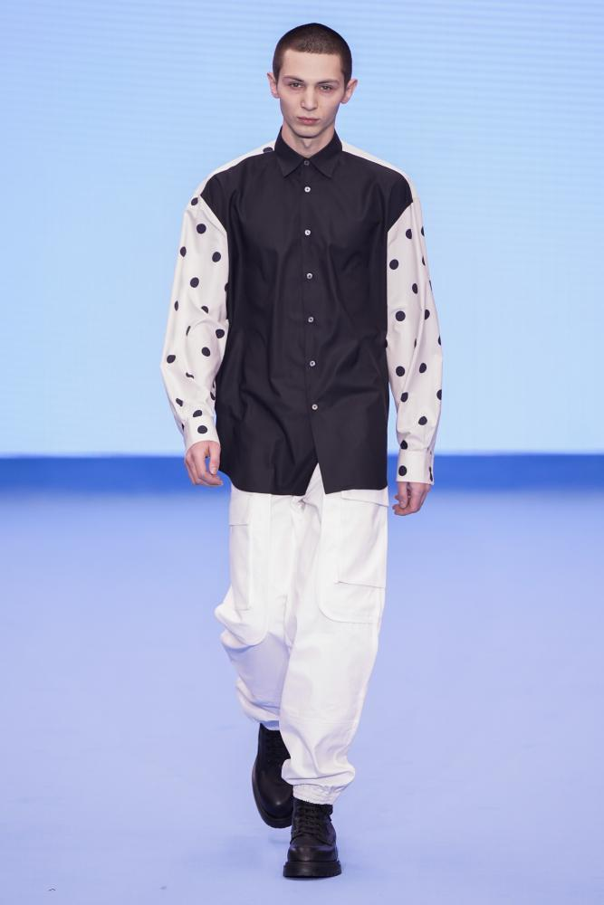 Trademark polka dots on the sleeves of an oversized shirt
