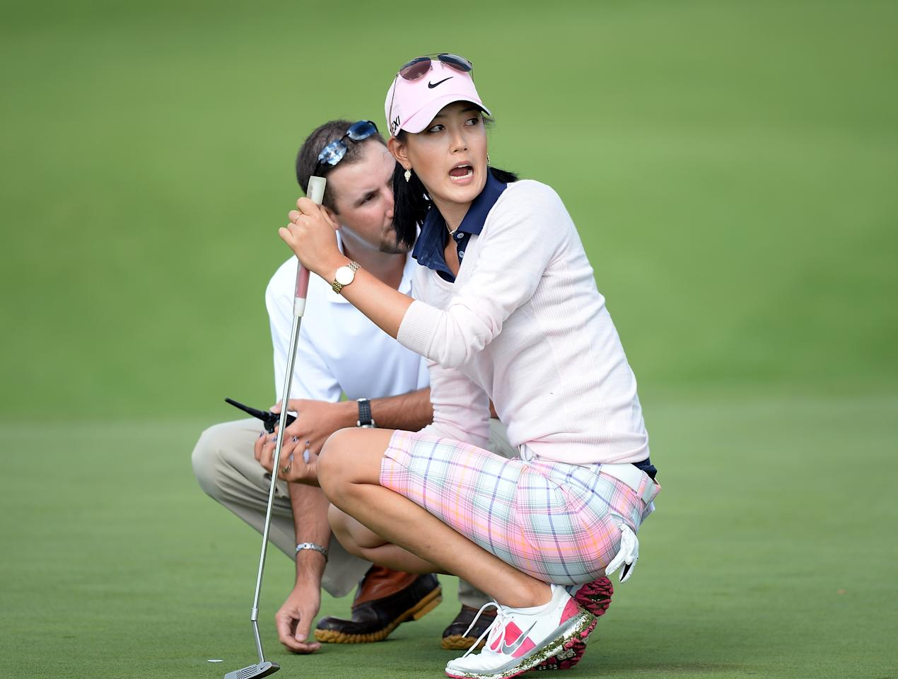 WATERLOO, CANADA - JULY 11: Michelle Wie reacts in front of a rules official on the third green during round one of the Manulife Financial LPGA Classic at the Grey Silo Golf Course on July 11, 2013 in Waterloo, Canada. (Photo by Harry How/Getty Images)