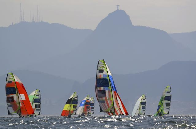 2016 Rio Olympics - Sailing - Preliminary - Men's Skiff - 49er - Race 7/8/9 - Marina de Gloria - Rio de Janeiro, Brazil - 15/08/2016. 49er mens sailors, including Sebastien Schneiter (SUI) of Switzerland and Lucien Cujean (SUI) of Switzerland (L), Joe Morris (USA) of USA and Thomas Barrows (USA) of USA (C) and Marco Grael (BRA) of Brazil and Gabriel Borges (BRA) of Brazil compete with Corcovado Mountain in the background. REUTERS/Brian Snyder FOR EDITORIAL USE ONLY. NOT FOR SALE FOR MARKETING OR ADVERTISING CAMPAIGNS.