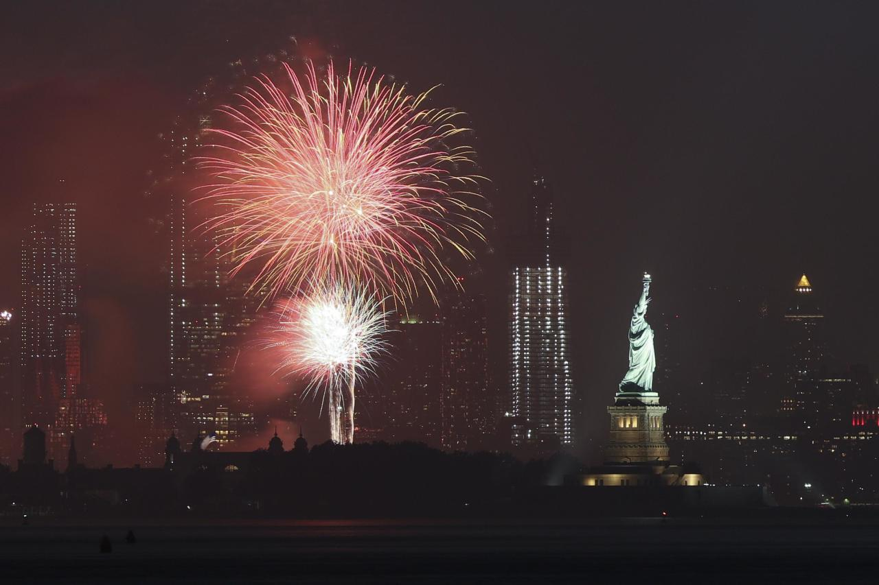 <p>Independence Day celebration fireworks explode above the Statue of Liberty on July 4, 2018 in New York City. (Photo: Liao Pan/China News Service/VCG/Getty Images) </p>