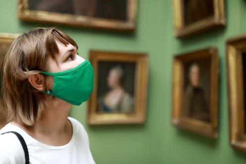 """<span class=""""caption"""">Galleries are great places for solo trips.</span> <span class=""""attribution""""><a class=""""link rapid-noclick-resp"""" href=""""https://www.shutterstock.com/image-photo/portrait-woman-wearing-protection-mask-museum-1779979442"""" rel=""""nofollow noopener"""" target=""""_blank"""" data-ylk=""""slk:Chubykin Arkady/Shutterstock"""">Chubykin Arkady/Shutterstock</a></span>"""