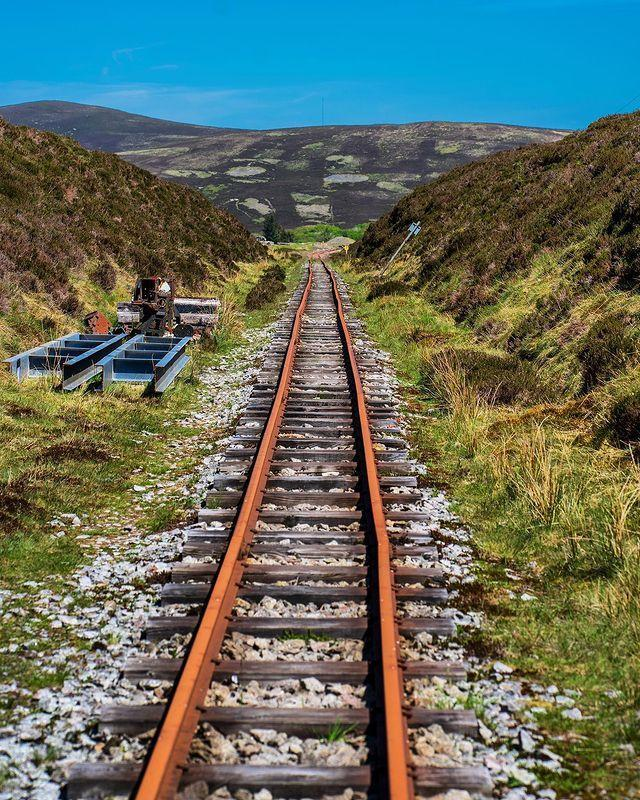 """<p>For something a little bit different, hop aboard a car on this narrow gauge railway which operates between Scotland's highest villages, Leadhills and Wanlockhead.</p><p>This is a line for railway and engineering lovers: the line itself was built on the track-bed of the former Caledonian Railway line, which closed in 1938, and the station at Leadhills boasts a collection of locomotives specially preserved from the industrial era.</p><p>The line also takes you to remote upland villages where you can learn about the region's industrial history, like the aptly-named Leadhills. This village is home to Scotland's highest course - not for the faint-hearted! </p><p>The lead mining museum at Wanlockhead teaches you about the history of industry, how lead miners dug to below sea level and excavated miles of tunnels looking for lead ore and silver.</p><p><a class=""""link rapid-noclick-resp"""" href=""""https://www.booking.com/city/gb/leadhills.en-gb.html?aid=1922306&label=scenic-railway-scotland"""" rel=""""nofollow noopener"""" target=""""_blank"""" data-ylk=""""slk:PLACES TO STAY NEAR LEADHILLS"""">PLACES TO STAY NEAR LEADHILLS</a></p><p><a href=""""https://www.instagram.com/p/CA2V4iul51i/"""" rel=""""nofollow noopener"""" target=""""_blank"""" data-ylk=""""slk:See the original post on Instagram"""" class=""""link rapid-noclick-resp"""">See the original post on Instagram</a></p>"""