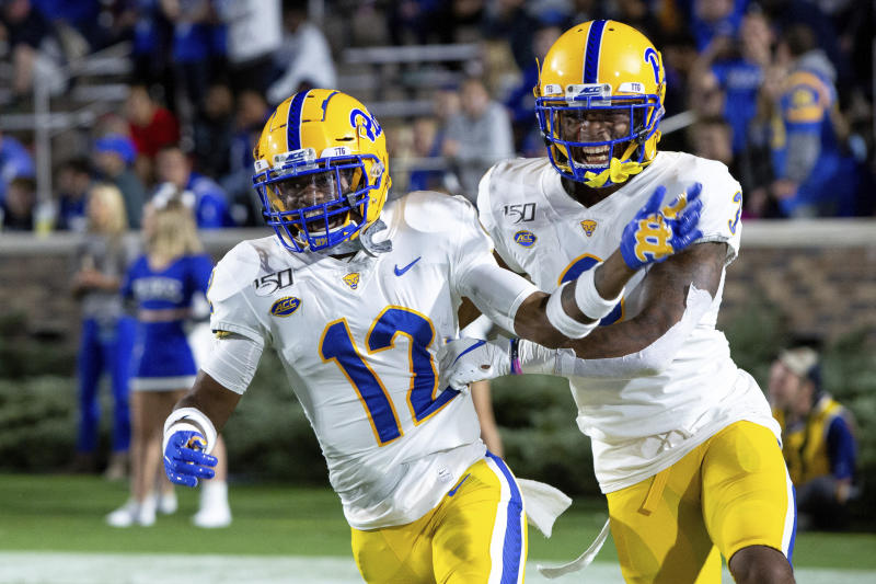 FILE - In this Oct. 5, 2019, file photo, Pittsburgh's Paris Ford (12) celebrates with Damar Hamlin after Ford scored a touchdown after an interception during the first half of an NCAA college football game against Duke, in Durham, N.C. Ford was selected to The Associated Press All-Atlantic Coast Conference football team, Tuesday, Dec. 10, 2019. (AP Photo/Ben McKeown, File)
