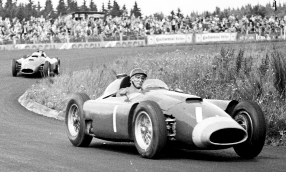 Ferrari's Juan Manuel Fangio leads Peter Collins in the 1956 German Grand Prix at Nürburgring. The Argentinian won the race while Collins retired.
