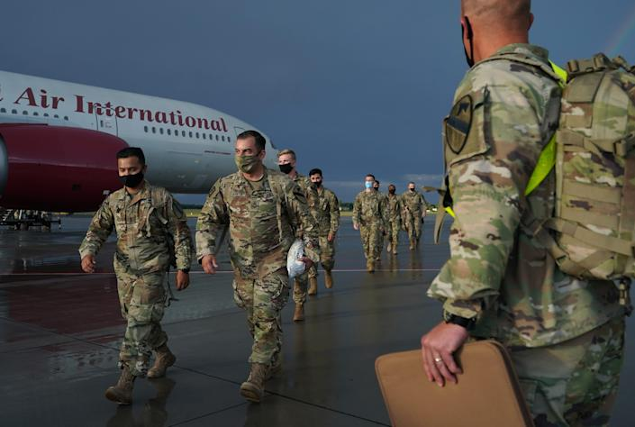 U.S. Army soldiers disembark from a plane upon arrival in Poznan, Poland, July 16, 2020. The Polish government expressed its willingness to host more U.S. troops.