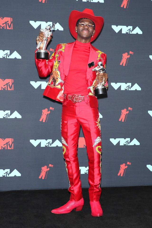 <p>Lil Nas X switched up his look at the 2019 VMAs with this rockin' red ensemble to collect his first-ever awards from the iconic MTV awards show.</p> <p><strong>What to wear:</strong> Red cowboy hat, red bedazzled jacket and pants, glittery belt, cross earrings. Don't forget your tiny sunglasses and maybe a couple trophies.</p>