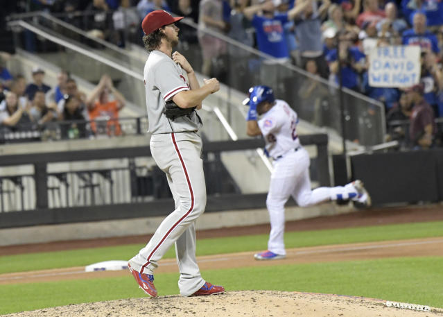 Philadelphia Phillies pitcher Aaron Nola, left, reacts as New York Mets' Dominic Smith, right, rounds the bases with a home run during the seventh inning of a baseball game Friday, Sept. 7, 2018 in New York. (AP Photo/Bill Kostroun)