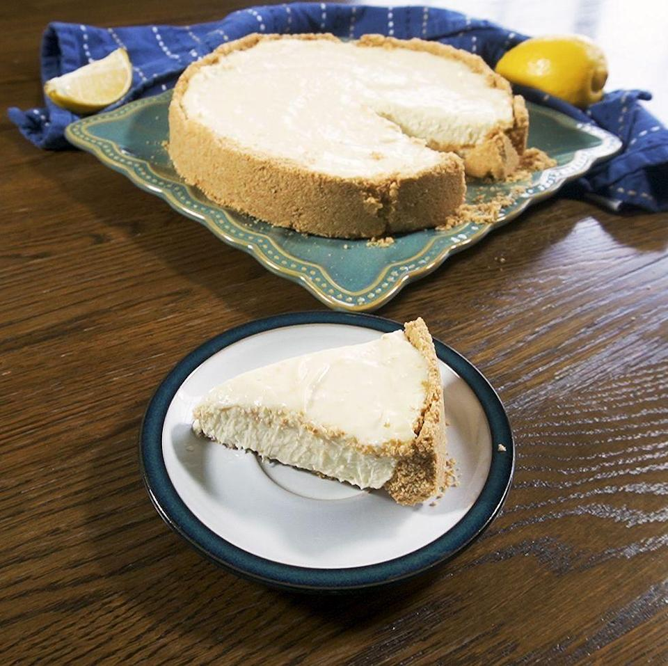 """<p>It's super simple: your classic two ingredient base is topped with a tangy and luxurious lemon cheesecake filling. The condensed milk adds glossy richness AND sweetness, while proper lemon zest and juice makes it taste like way more time, effort and ingredients went into this masterpiece.</p><p>Get the <a href=""""https://www.delish.com/uk/cooking/a35264347/lemon-cheesecake/"""" rel=""""nofollow noopener"""" target=""""_blank"""" data-ylk=""""slk:Lemon Cheesecake"""" class=""""link rapid-noclick-resp"""">Lemon Cheesecake</a> recipe.</p>"""