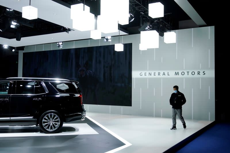 FILE PHOTO: General Motors sign is seen at the third China International Import Expo (CIIE) in Shanghai