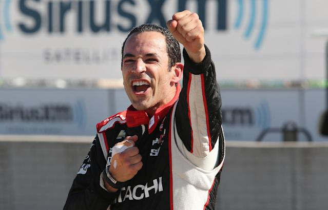 Helio Castroneves celebrates after winning the second race of the IndyCar Detroit Grand Prix auto racing doubleheader in Detroit Sunday, June 1, 2014. (AP Photo/Dave Frechette)