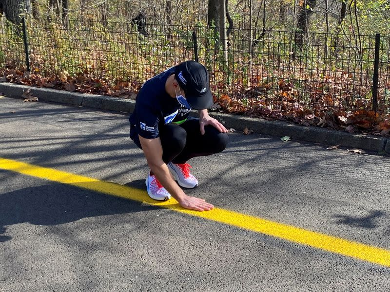 """Thomas Panek, a blind runner and CEO of Guiding Eyes for the Blind, gets ready for a 5K run in Central Park where he will use Google's """"Guideline"""" app instead of help from a human or guide dog, in New York"""