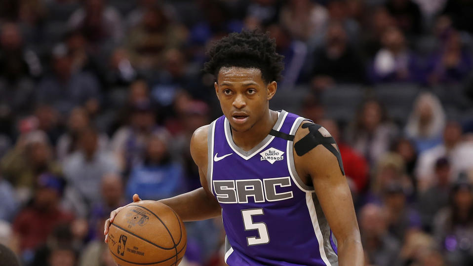 Sacramento Kings guard De'Aaron Fox dribbles down court during the second half of an NBA basketball game against the Toronto Raptors in Sacramento, Calif., Sunday, March 8, 2020. The Raptors won 118-113. (AP Photo/Rich Pedroncelli)